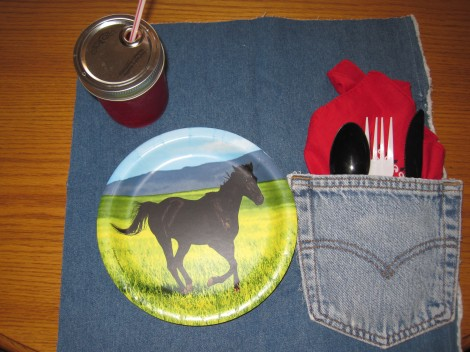 Party place setting with jelly jar, pocket bandana napkin, and plastic ware
